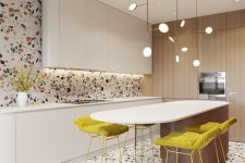 a bright and fun kitchen with a colorful terrazzo floor and wall, white curved cabinets, a curved kitchen island and mustard stools