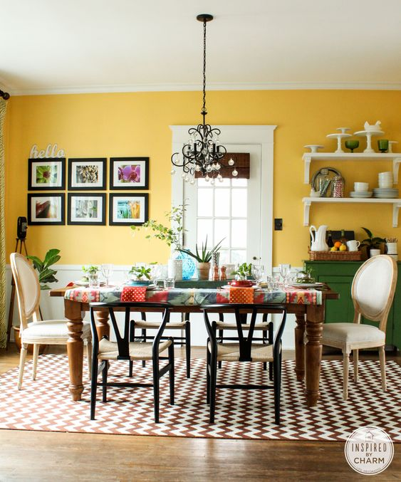 a dining room with a gallery wall