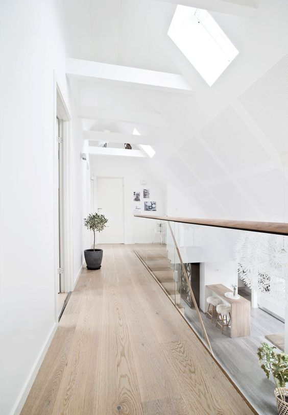a stylish attic space with hardwood flooring