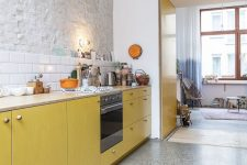 a cool kitchen with lots of terrazzo on floors and walls