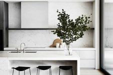 a lovely minimalist kitchen with sleek white cabinets and a kitchen island, an open shelf, built-in lights and a glazed wall for a view