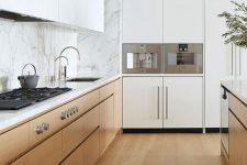 hardwood flooring makes this minimalist kitchen cozy