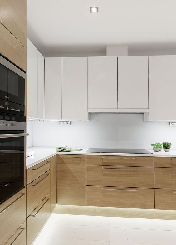 a minimalist kitchen with stained and white cabinets, a white backsplash and countertops plus built-in lights is amazing