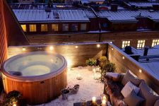 a rooftop terrace with a hot tub