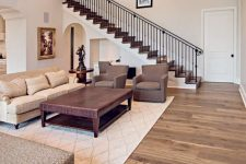 a simple yet cozy living room with hardwood flooring