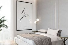 a refined minimalist bedroom in neutrals with an upholstered bed, glass side tables, a statement artwork and built-in lights
