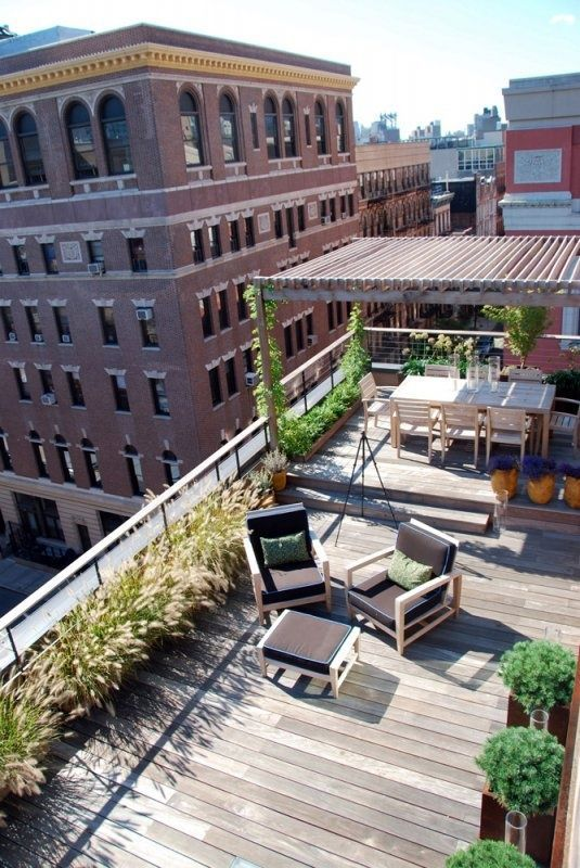 a rooftop terrace with a wooden deck, growing plants and greenery, a dining space with a wooden set is a lovely space
