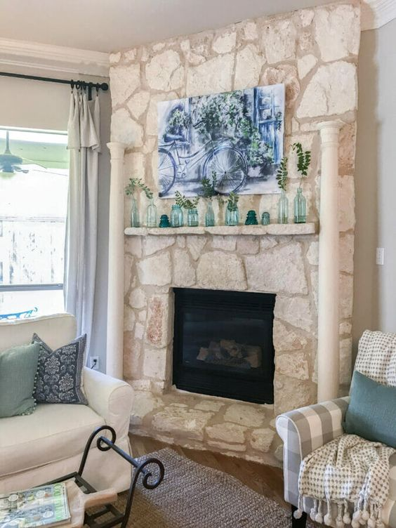a simple summer mantel with various bottles and jars, with a beautiful blue watercolor over it is cool