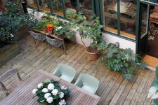 a practical deck with dining and potting areas