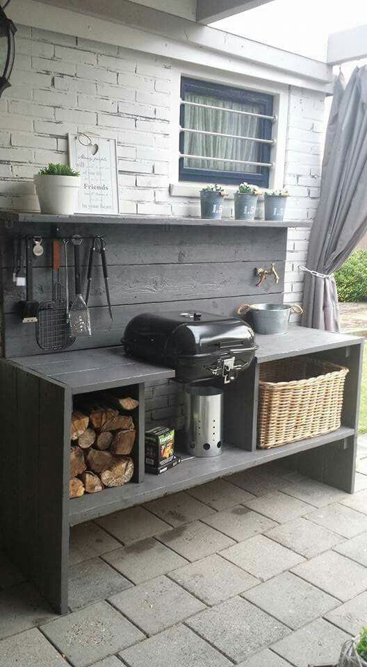 a cute outdoor summer kitchen with a girll