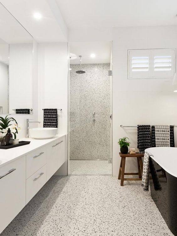 a stylish white bathroom with durable flooring