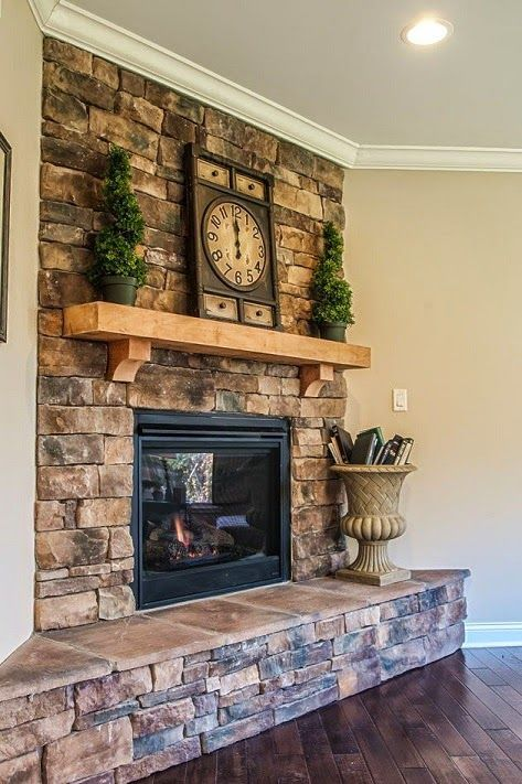 a summer farmhouse mantel with potted mini trees and a vintage clock is a simple and fresh idea for the season