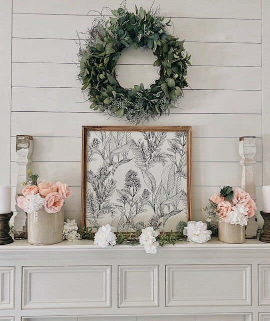 a greenery wreath always looks great above a mantel