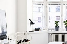 an all-white Scandinavian bedroom design