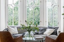 a cute Parisian living room design with large windows