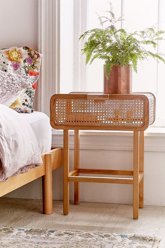 a beautiful and lightweight cane nightstand with a single drawer is a very chic and refined piece for a modern or boho room