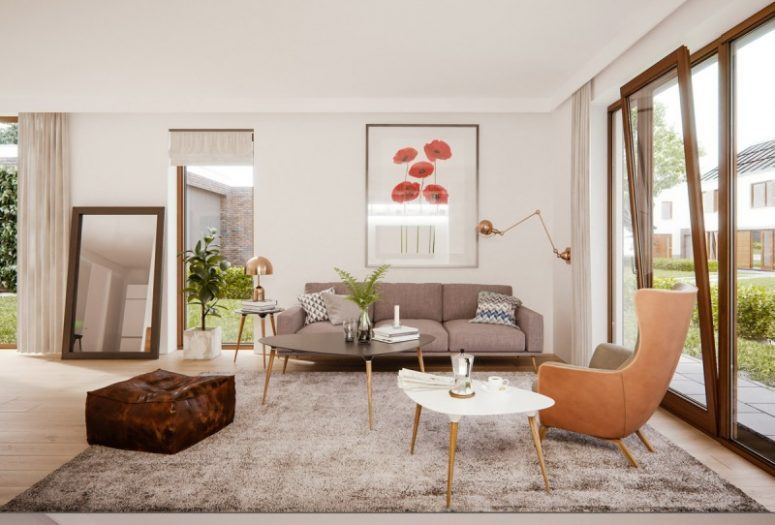 a beautiful mid-century modern living room with a grey sofa and a large rug, a greige egg-shaped chair, a duo of coffee tables, elegant copper lamps