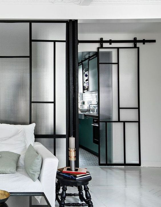a beautiful patterned glass and black metal sliding door is a cool idea for a modern or Scandinavian home
