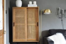a cute rattan cabinet is a nice addition to a moody room