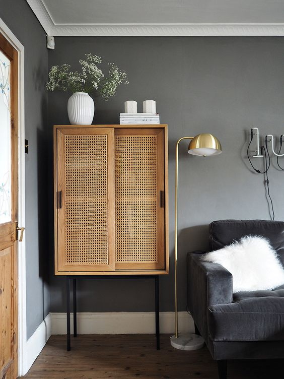 a beautiful rattan cabinet with sliding doors can be used as a home bar or a storage unit and is a great solution for any space