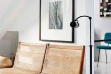 a beautiful vintage cane bench is a stylish idea for a modern space, it's a soft addition with a slight vintage feel