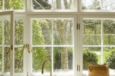 a big white French window is an ideal fit for a Provence-styled kitchen done in neutrals, it brings a lot of natural light and cool views