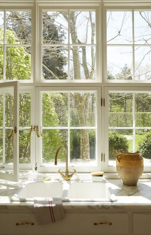 a big white French window is an ideal fit for a Provence styled kitchen done in neutrals, it brings a lot of natural light and cool views