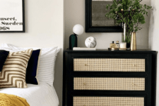 a black dresser with cane drawers is a wonderful contrasting unit used as a nightstand is a very chic solution for a modern bedroom