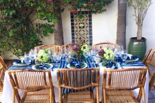 a bright Mediterranean dining zone with bold textiles and cool bamboo chairs that add a relaxed feel to the space