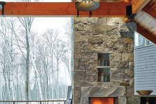 an outdoor stone fireplace is perfect to spend times during long winter nights