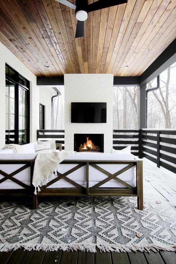 a cool screened porch design in b&w tones