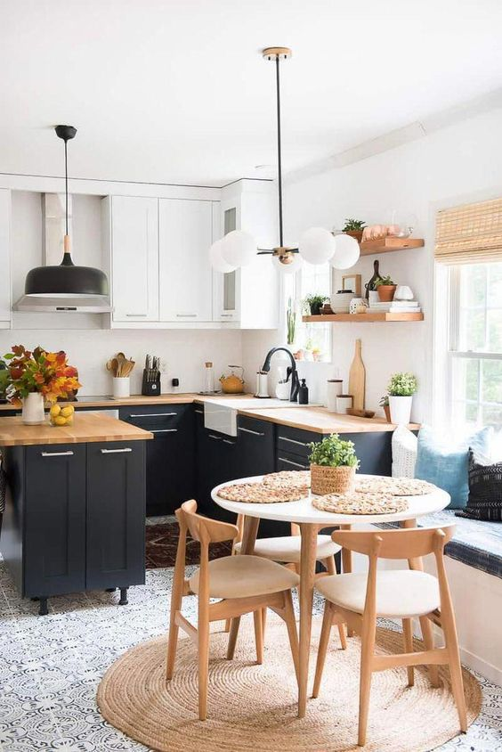 a cool mid-century modern kitchen with graphite grey and white kitchen with butcherblock countertops, a round table and wooden chairs, wooden open shelves