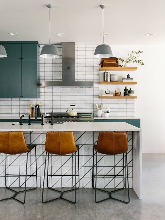 a fantastic mid-century modern kitchen with green cabinets, a white kitchen island, open shelves and leather stools