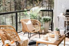 a gorgeous boho balcony with rattan and wooden furniture, printed rugs and pillows, potted greenery and a cool forest view