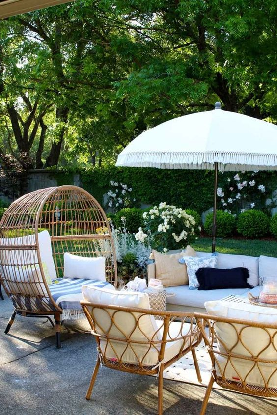 a stylish outdoor space with rattan furniture