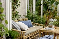 a lovely boho space with a tiled floor, bamboo furniture, printed textiles, potted plants and trees is a very welcoming one