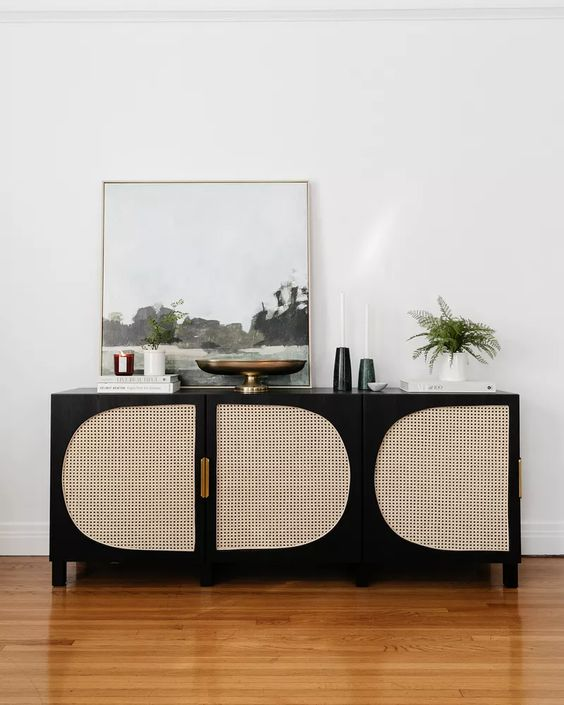 a lovely media console of an IKEA piece, in black and with cane doors is a very cool idea for a refined room