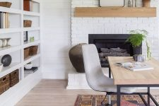 a cozy home office with a white brick fireplace