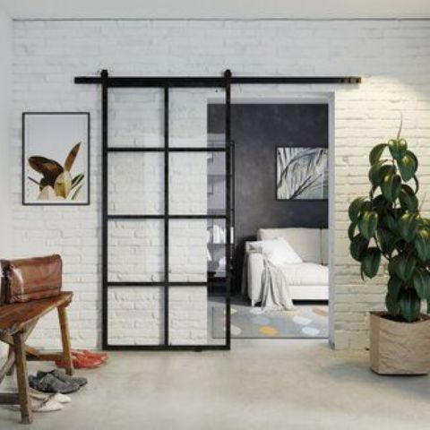 a modern French glass door with metal framing is a lovely idea for a modern space, it stands out but still lets light in and out