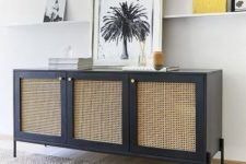 a navy storage unit with cane doors and gold knobs is a chic solution with a bold color combo that will make your space eye-catchy