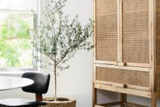 a neutral storage unit with cane doors is a beautiful and lightweight solution for a modern space, whatever this space is