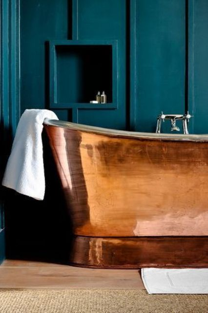 a polished copper bathtub with a chromatic faucet is a stylish and bright and shiny glam idea to rock