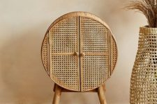a pretty and chic cane cellarette, a cupboard for alcohol bottles, is a beautiful piece for any modern space