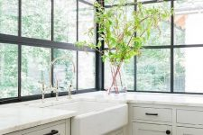 a cozy farmhouse kitchen design with large windows
