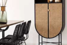 a refined black storage unit with cane doors is a very chic and gorgeous solution for any modern space, can be used as a bar or as a display unit