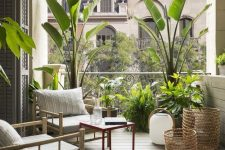 a simple and welcoming outdoor space with bamboo furniture, baskets, candle lanterns and potted tropical plants is lovely