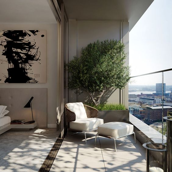a small and cool balcony with some potted plants, a woven chair with a footrest and a gorgeous view of the city is an ultimate idea