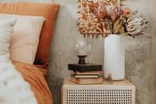 a small and cool nightstand with a cane door is a lovely idea to brign a touch of retro chic to your bedroom