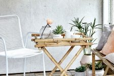 a small bamboo folding table is a great idea for an indoor or outdoor space, it can be folded any time