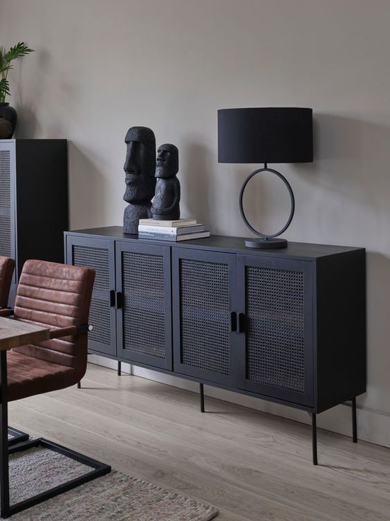 a sophisticated modern black buffet with cane doors is a fresh and modern take on thos traditional pieces that looks edgy